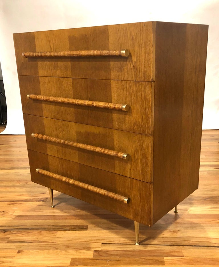 Original chest of drawers in walnut with reed handles and brass accents designed buy T.H. Robsjohn Gibbings for Widdicomb. The wood and reed have been lightly restored and the brass accents and legs have been hand polished. This elegant and iconic