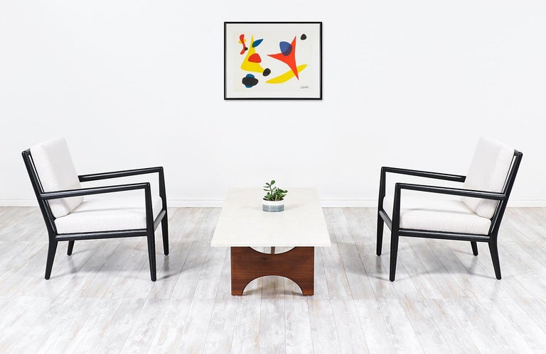 T.H. Robsjohn-Gibbings ebonized lounge chairs for Widdicomb.