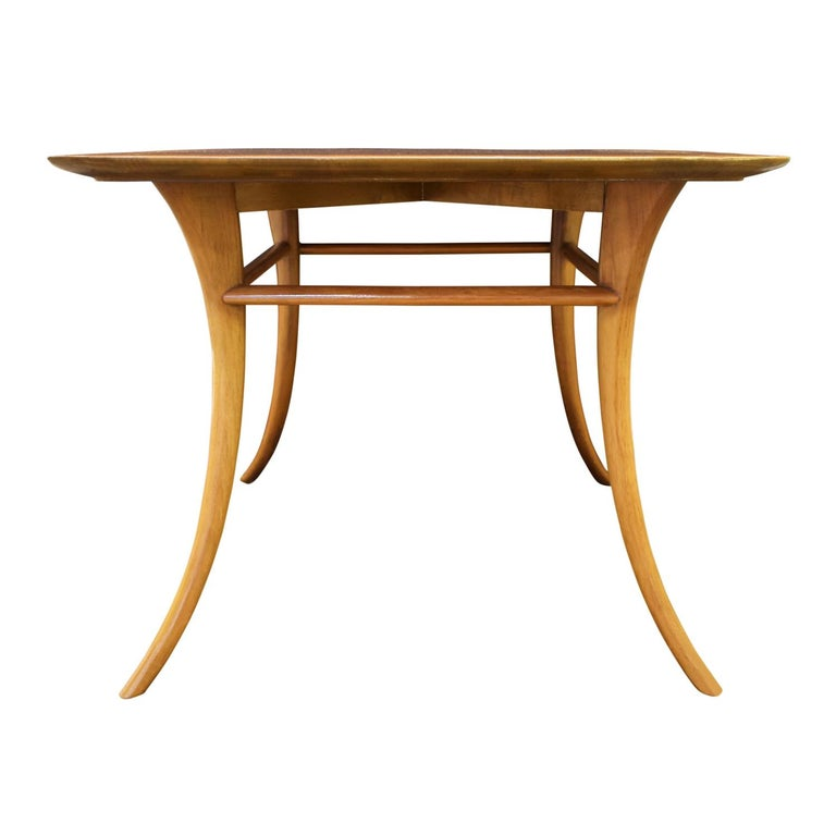 Square end table in walnut with Klismos legs by T.H. Robsjohn-Gibbings for Widdicomb, American 1956 (Signed and dated on bottom). Robsjohn-Gibbings was inspired by ancient Greek furniture. This is an iconic Robsjohn-Gibbings design.