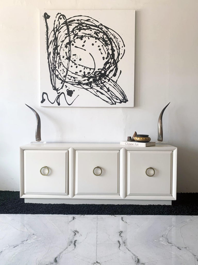 Available right now I have this absolutely stunning T.H. Robsjohn Gibbings for Widdicomb credenza. This stunner has been expertly refinished and lacquered white for a timelessly chic look that any mid century modern aficionado would approve