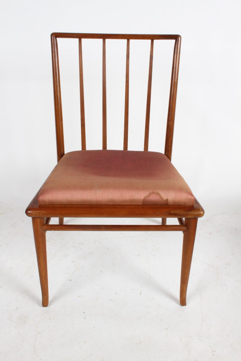 Listed is a single classic slat back dining chair by T.H. Robsjohn-Gibbings for Widdicomb. Shown in original finish, but includes refinishing in color shown or dark espresso, custom color options available. New foam and upholstery extra. Can be used