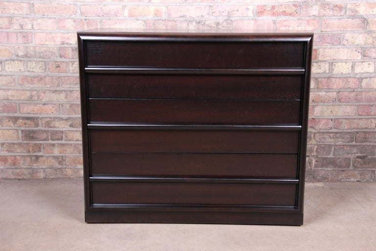 An exceptional Mid-Century Modern ebonized walnut three-drawer dresser chest