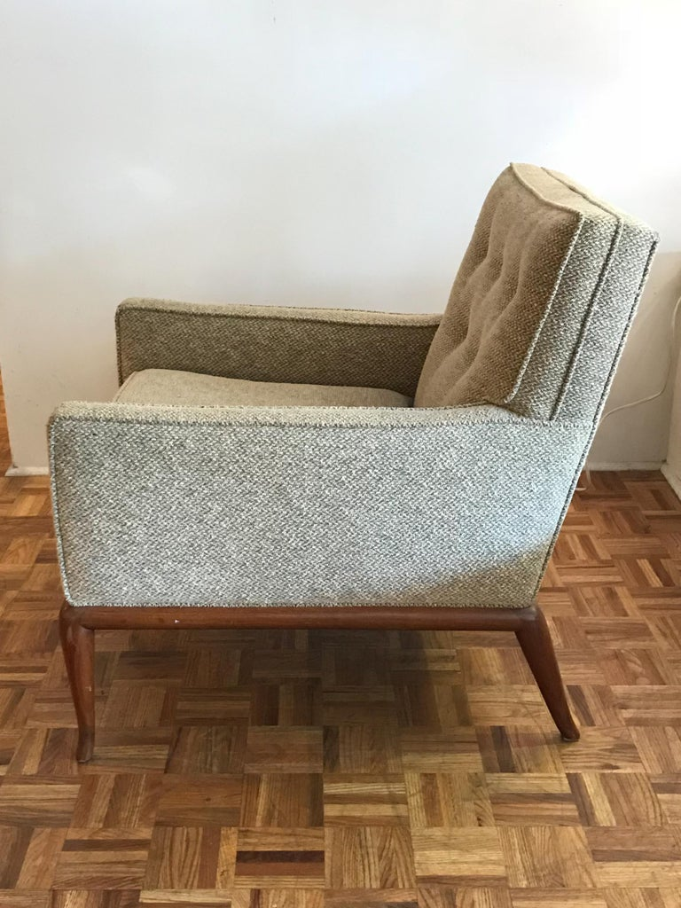Pair of elegant T.H. Robsjohn-Gibbings for Widdicomb armchairs. Walnut frames with what looks to be original upholstery. Frames are in vintage condition with minor wear consistent with age and use.