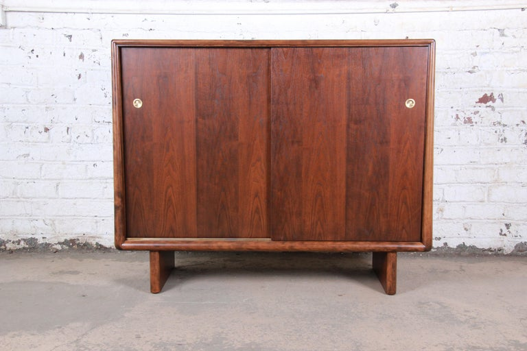 An extemely rare and exceptional mid-century modern sculpted walnut 13-drawer gentleman's chest dresser or cabinet