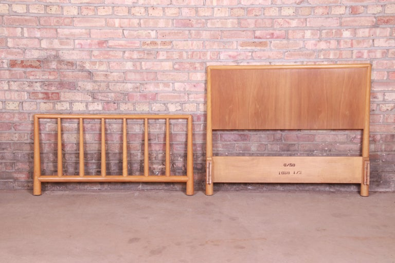 A gorgeous Mid-Century Modern walnut twin size headboard and footboard