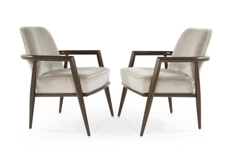 Pair of lounge chairs designed by T.H. Robsjohn-Gibbings for Widdicomb, walnut frames fully restored. Newly upholstered in beige mohair.
