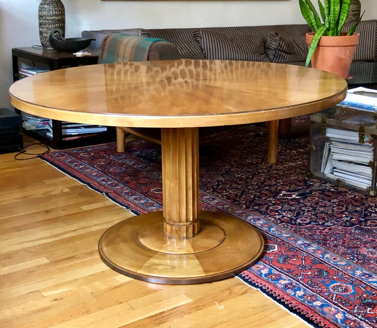 Elegant neoclassically styled centre or lamp table from the rare one year collaboration with Baker furniture in 1961. The fluted walnut center pedestal sits on a brass rimmed base. The top surface is veneered in a star pattern with burl center