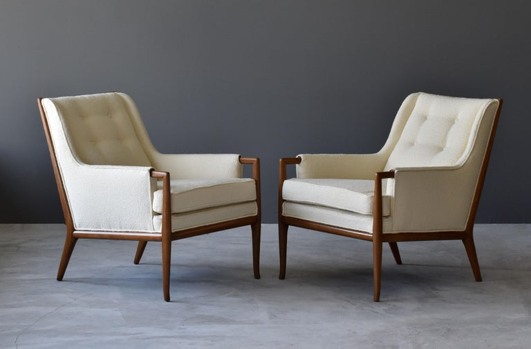 A pair of rare lounge chairs designed by T.H. Robsjohn-Gibbings. Produced by Widdicomb Furniture Company in Grand Rapids, Michigan, circa 1950s.  Other American designers of this era are Edward Wormley, George Nakashima, Tommi Parzinger, Paul