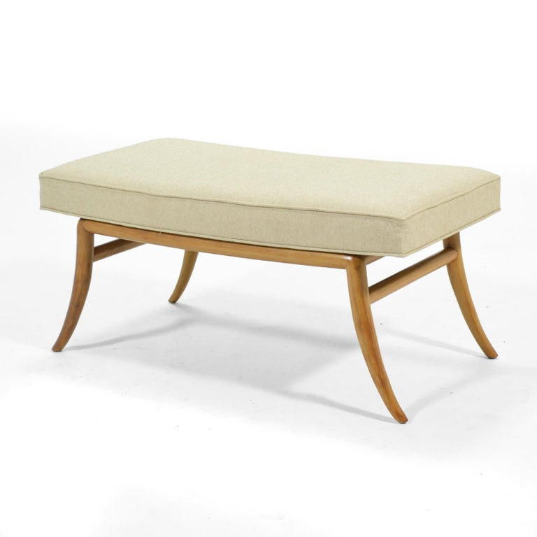 We think this design by T.H. Robsjohn-Gibbings perfectly reflects the designer's character: refined, elegant, and sophisticated. The model 2021 features his distinctive saber leg to support a simple upholstered bench–perfect for the foot of the