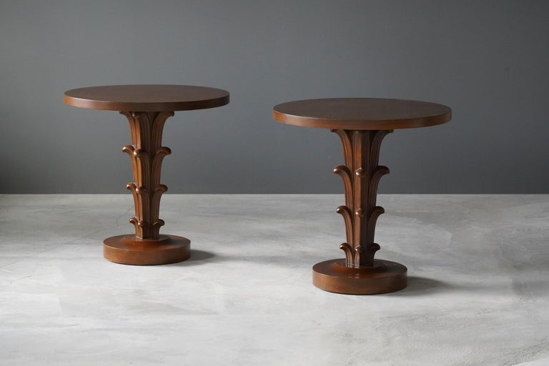 A rare pair of side tables / end tables / occasional tables. Designed by British / American designer T.H. Robsjohn-Gibbings. Produced by Widdicomb Furniture Company, Grand Rapids, Michigan. Bears stencil marking from Widdicomb aswell as retail