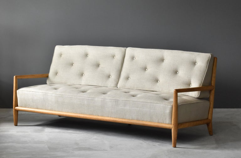 A sofa, model 1678, designed by T.H. Robsjohn-Gibbings for Widdicomb Furniture Company, Grand Rapids, Michigan. 