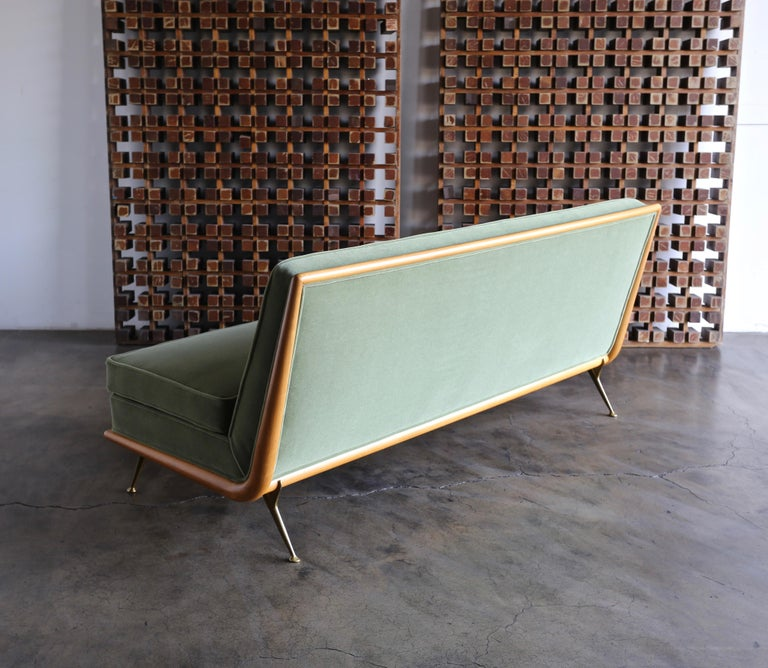 T.H. Robsjohn-Gibbings sofa, Model 1727 for Widdicomb, circa 1955. This piece has been professionally restored. The upholstery is Maharam Mohair Supreme: Sage.