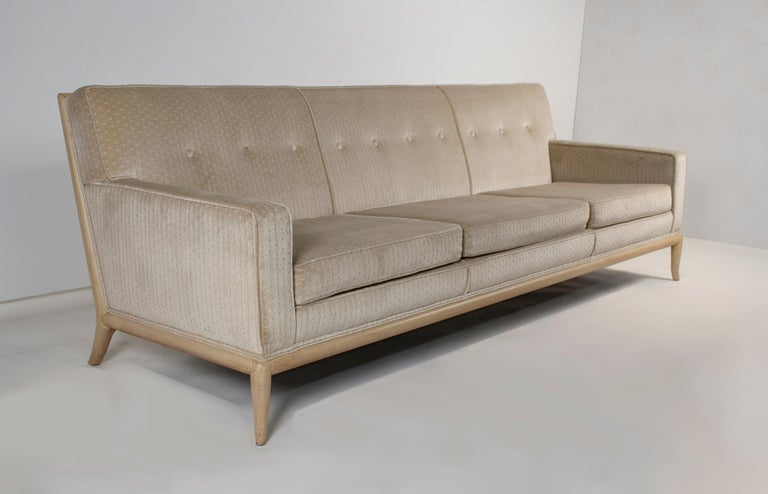 Unique Robsjohn Gibbings sofa upholstered in a soft Chenille textile with a custom ordered bleached walnut frame. This sofa is very comfortable as it has an 8-way hand-tied spring system tucked into the frame. Constructed with solid hardwoods this