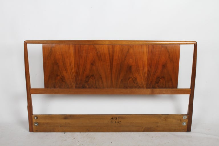 T.H. Robsjohns-Gibbings for Widdicomb full size headboard with book matched walnut. It seems to have been refinished at some point. Shows minor wear. Mounting hardware at 51.25