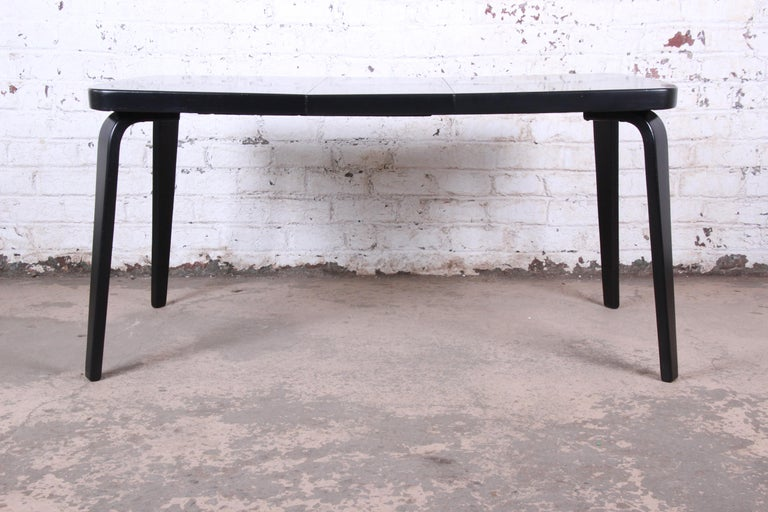 A gorgeous Minimalist Mid-Century Modern black lacquered bentwood birch extension dining table