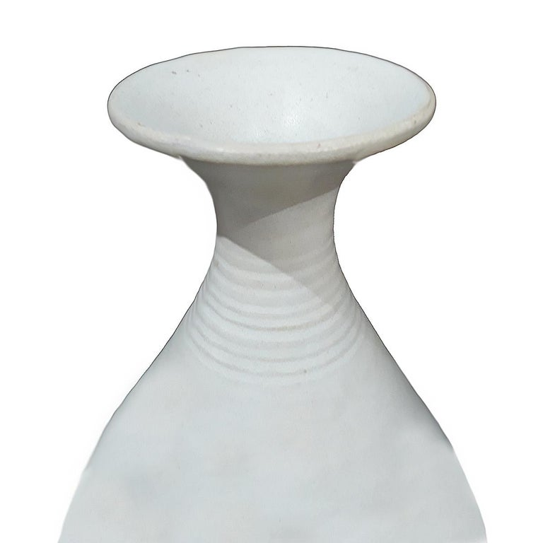 A white ceramic vase from Thailand, circa 1900. Smooth finish, ribbed neck.