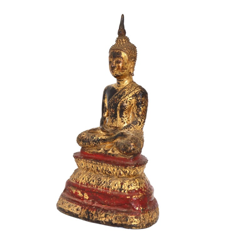 Thai gilt bronze figure of a seated Buddha, depicted with legs crossed in the vajrasana position with the feet resting on the thighs soles up, believed to be the position the Buddha was in when he achieved enlightenment hands overlapping palms up