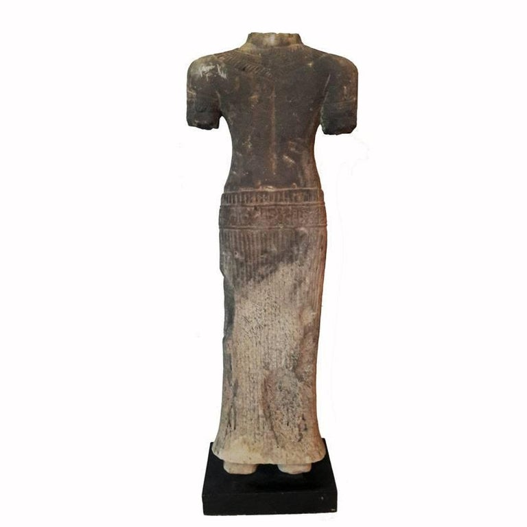 A hand-carved sandstone statue, female, from Thailand, late 20th century. Mounted on a wood stand. Measure: 27