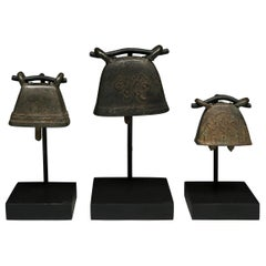 Thailand, Early 20th Century, Set of Three Brass Goat Bells on Stands
