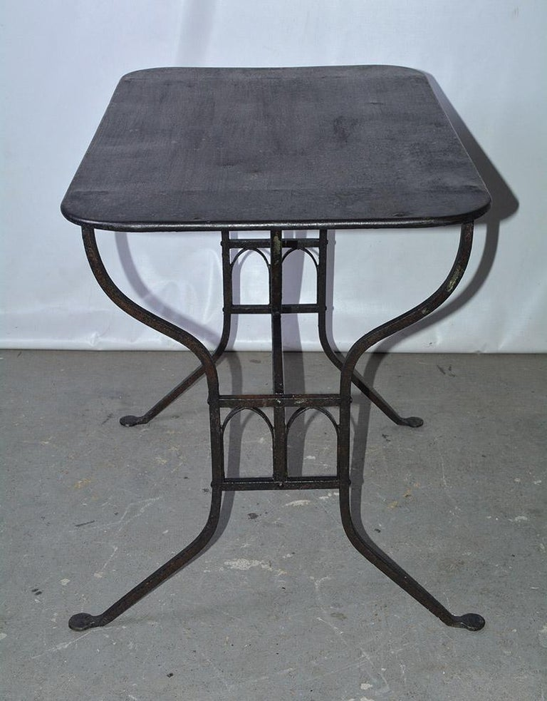 Hand-Crafted 19th Century French Iron Bistro Table with Faux Gothic Stretcher For Sale