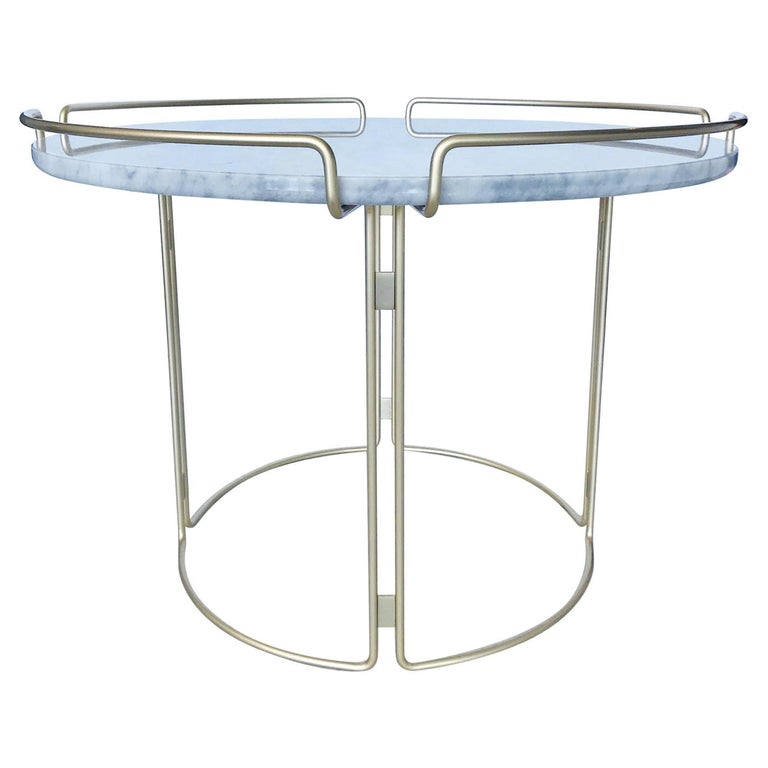 Gorgeous side table designed by Fabrice Berrux for Roche Bobois. Table has a Mid-Century Modern inspired design. Features white Carrara marble top with round three-sided steel wire frame in lacquered matte gold or satin brass finish.