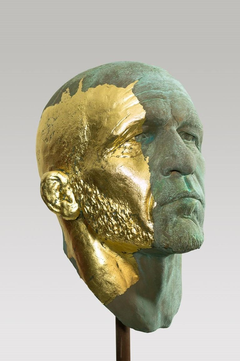 This extraordinary sculptural portrait head takes its beginnings from classical antiquity. Attention to detail and complete understanding of the human figure are evident. Kugler adds a modern twist to this classical style by using a splatter of gold