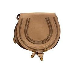 The bohemian Chloe Marcie Mini Saddle Bag featuring adjustable shoulder strap.