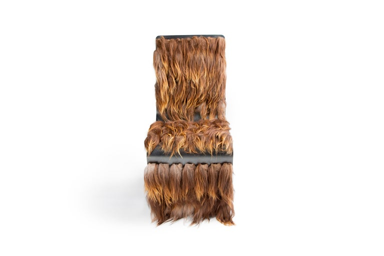 Star Wars fans will be talking! This steel chair weaves Icelandic fur into the intricate steel cutouts to make a statement piece for any contemporary environment. Handmade in Bozeman, Montana, this eclectic piece offers comfort, durability and