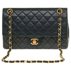 The Classy Chanel Timeless 25cm Shoulder bag in black quilted lambskin and GHW