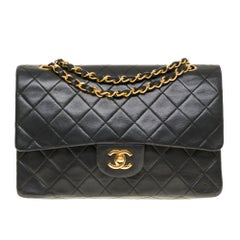 The Classy Chanel Timeless Medium Shoulder bag in black quilted lambskin and GHW