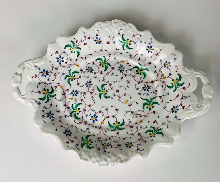 Provenance: The Private Collection of Mario Buatta a group of three shaped dishes decorated with similar red and green floral patterns. Made of earthenware in England circa 1830 this group of three dishes have a lovely informal feel. Mario