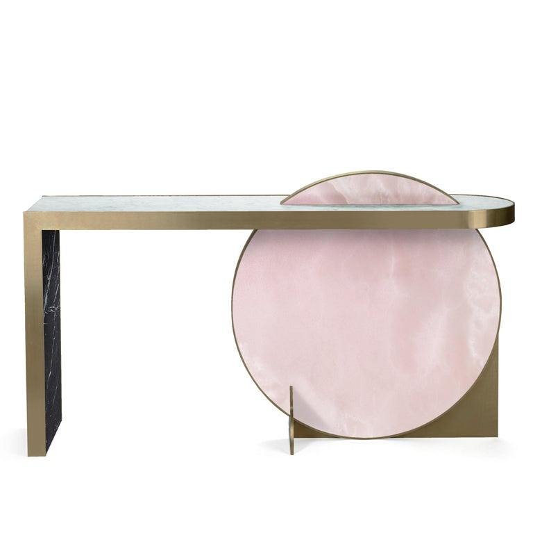 Inspired by the planets and their orbital movements, a recurrent theme in Lara Bohinc's work, the Lunar Collection features important pieces of furniture, with highly-figured marbles set like jewels within golden rims. Disc shapes bisect or overlay