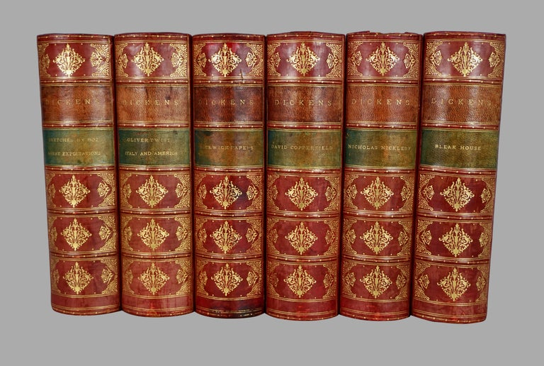 The complete illustrated works of Charles Dickens in 15 leatherbound and marbleized paper bindings, published in New York by George Routledge and Sons. This set includes all the classics like Bleak House, Nicholas Nickleby and David Copperfield with