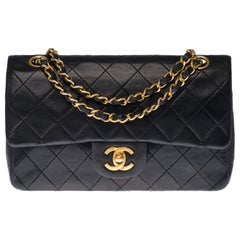The Coveted Chanel Timeless 23cm Shoulder bag in black quilted lambskin and GHW
