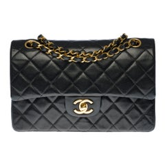 The Coveted Chanel Timeless 23cm Shoulder bag in black quilted lambskin, GHW