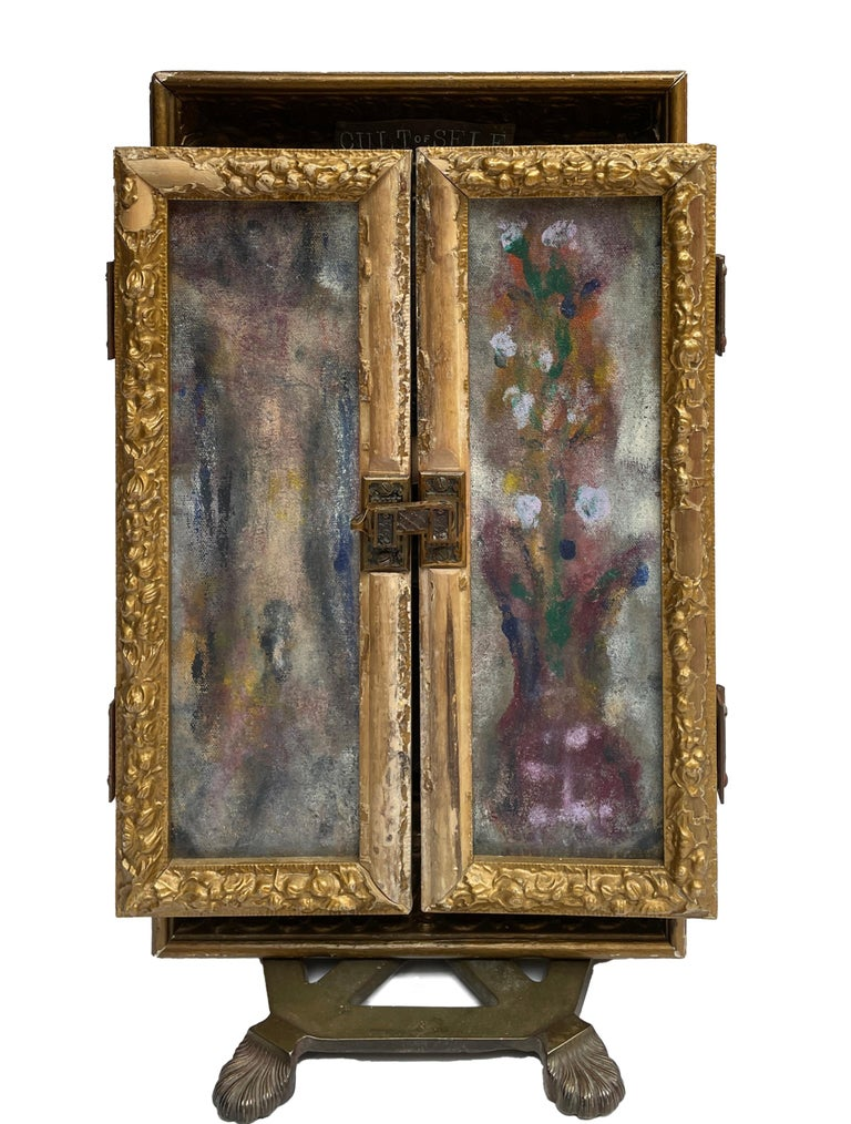 Self-taught artist John Seubert, AKA John Dolly, uses objects he uncovers as he rehabs older homes in Chicago. This piece has two handmade frames mounted side by side. Each side is a different treasure to discover. The front frames are two abstract