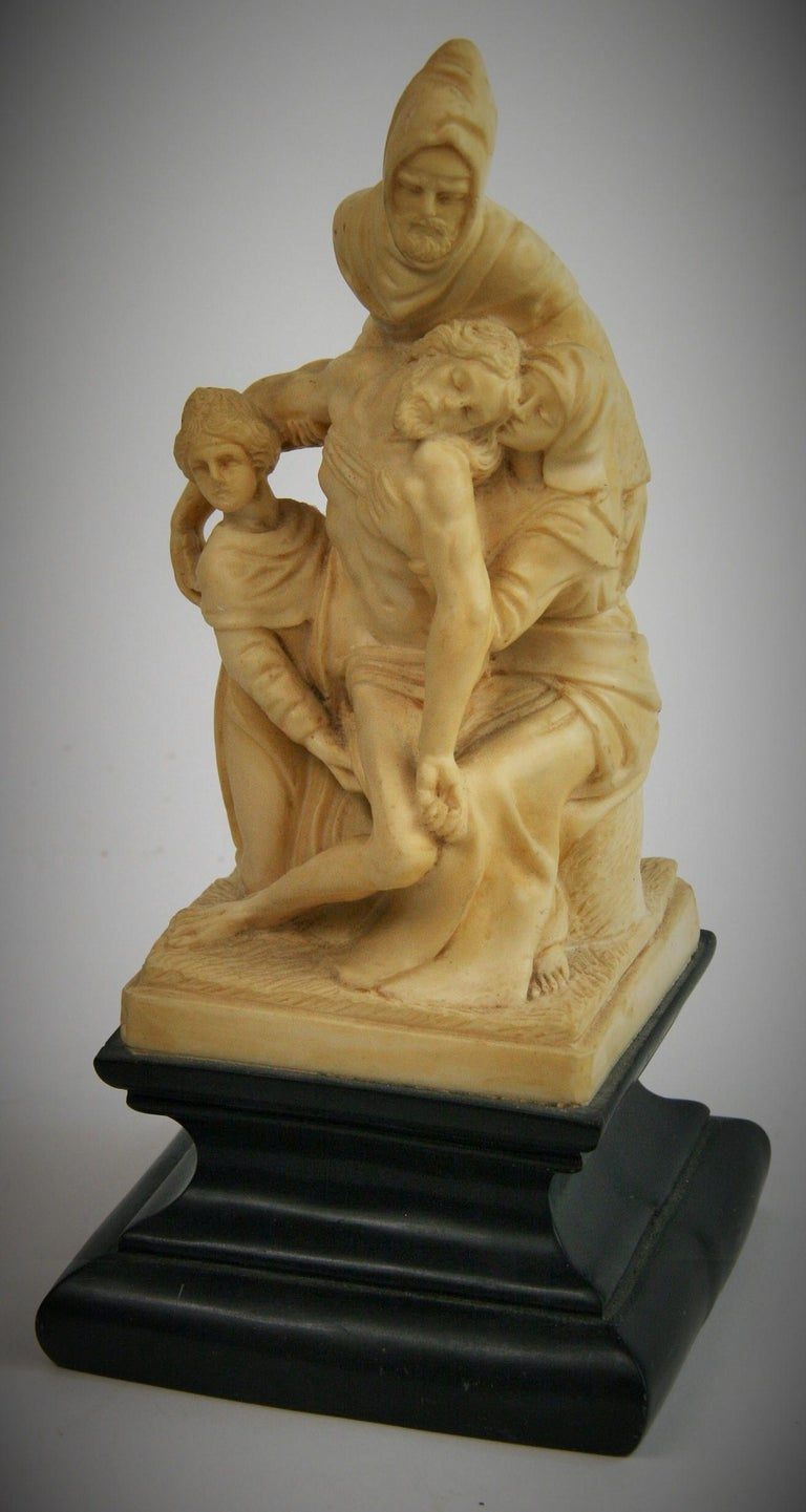 2-291 The Deposition sculpture by Michelangelo done between 1547 and 1555 originally in marble depicting Nicodemus, the dead body of Christ, Mary Magdalene and Virgin Mary. This reproduction done in marble cast stone composition in Italy, 1970s.