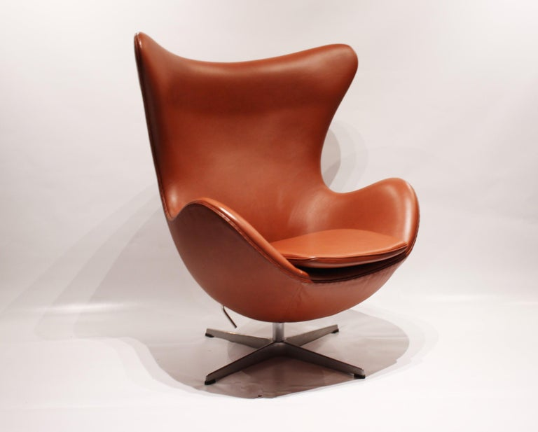 The Egg, model 3316, designed by Arne Jacobsen in 1958 and manufactured by Fritz Hansen in 2016. The chair is upholstered with cognac colored leather and is in great vintage condition. The chair was designed along with the Swan chair for a project