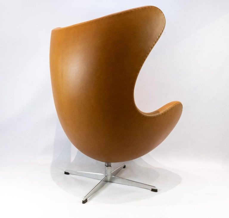 The Egg, model 3316 designed by Arne Jacobsen in 1958 and manufactured by Fritz Hansen. The chair is upholstered in cognac colored leather and is in great condition.