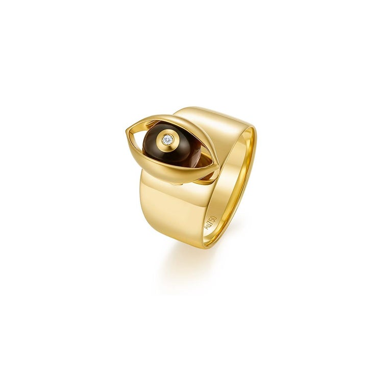 Details: 18 karat yellow gold, tiger's eye, ruby, diamond H:2.8cm, W:1.5cm  We carefully selects each of our collection gemstones. As they are natural, the colour may vary from one creation to another  With characteristic flair, ZEEMOU ZENG'S new