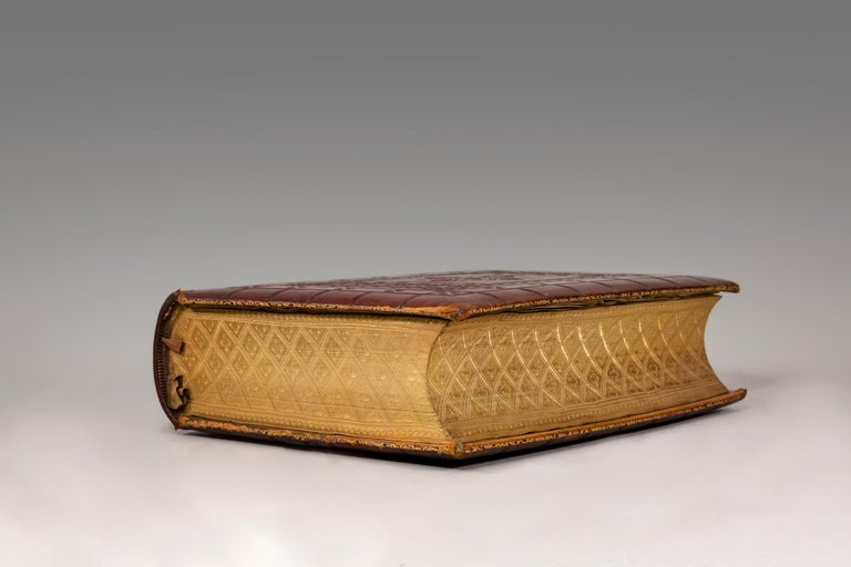 Various authors  One volume. Folio. Containing theold and new testaments. Bound in full brown morocco, blind tooling on covers & spine by Bagster. Raised bands with silk doublures. It contains 7 original illuminated leaves on vellum with