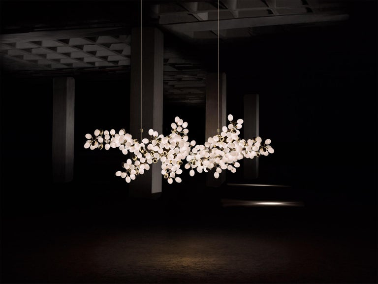 Inspired by the resplendent natural forms of ancient flora, this collection is rigorously crafted in hand-blown Murano glass and solid sculpted bronze (or stainless steel).  Description: Horizontal Valiant Chandelier  Dimensions: Approx. 108
