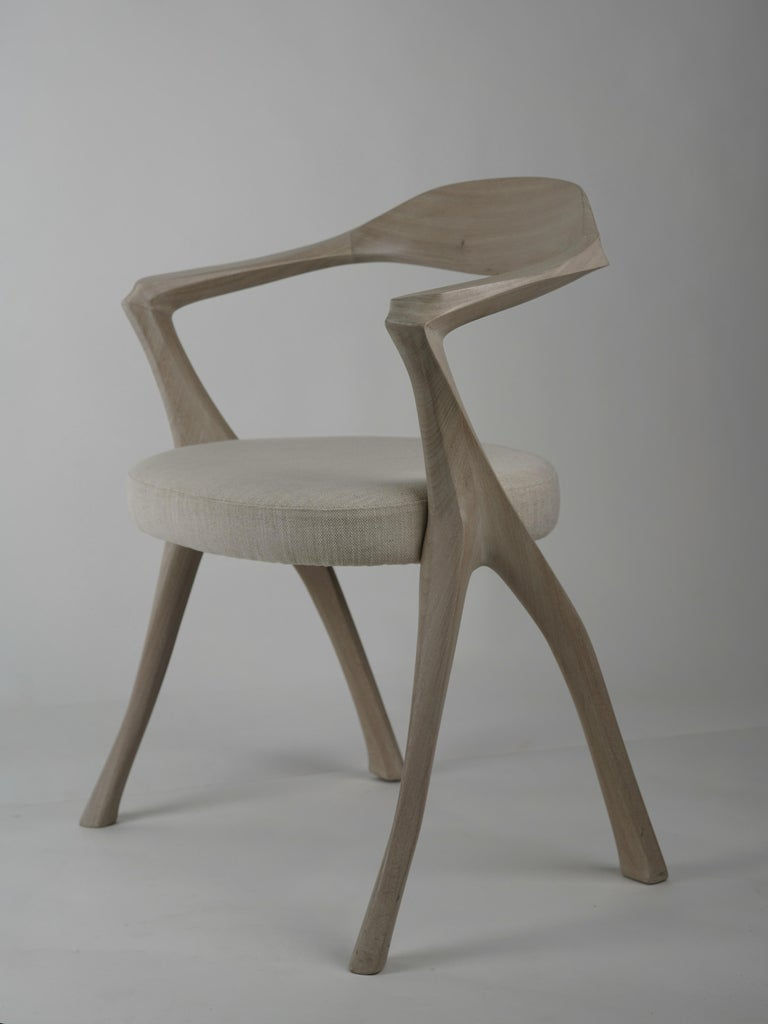 Designed as a companion to the Howard table, the Homage chair is a tour de force of sculptural carving. There is an understated elegance to each of its elements which echoes, in an unornamented Minimalist spirit, the Classic architecture of 18th