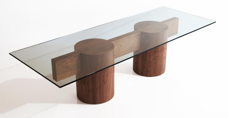 Kimono table by William Earle. The substantial tenon is inset into the drums. Shown with 8' tenon and 10' glass; can be scaled down for less grand applications. Listing does not include glass, but glass can be added. Shown in American walnut.