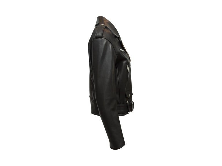 Product details: Black leather moto jacket by The Kooples. Silver-tone hardware. Notched lapel. Belt accent at waist. Zip closure at front. 34