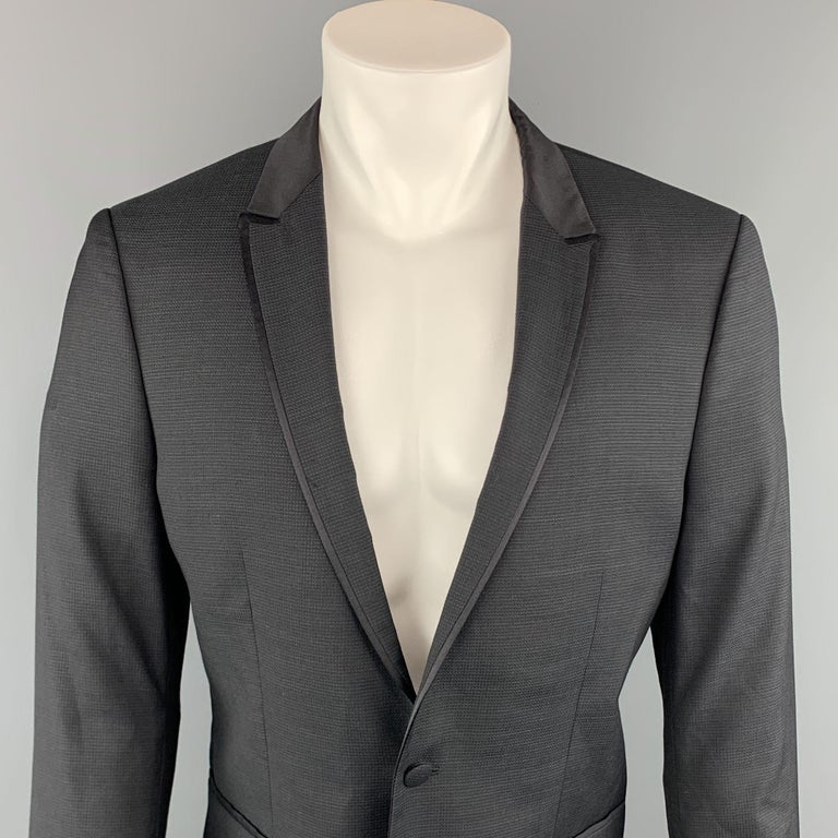 THE KOOPLES sport coat comes in a black nailhead wool with a peak lapel and a single button closure.     Excellent Pre-Owned Condition.  Marked: 52  Measurements:  Shoulder: 17 in.  Chest: 40 in.  Sleeve: 26.5 in.  Length: 27.5 in.