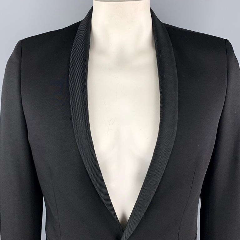 THE KOOPLES Fitted Sport Coat comes in a black solid wool material, with a shawl collar, a single button at closure, single breasted, slit pockets, functional buttons at cuffs, and a double vent at back.  Excellent Pre-Owned Condition. Marked: IT