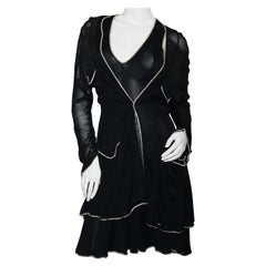 The little black dress by Chanel  black and white silk  Sculpted figure