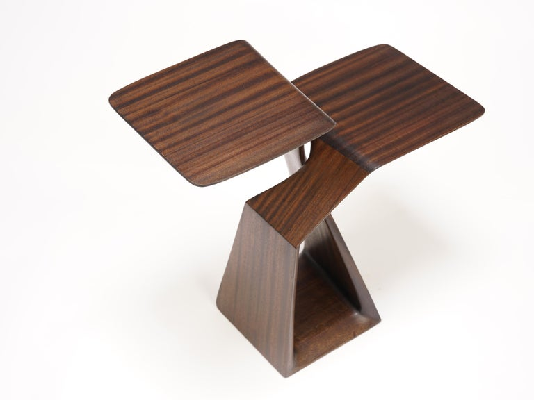 This little sculpted drink stand, clearly organic, yet simultaneously abstract and Minimalist, expresses a surprising primitive energy and dynamism. Its two elements rise and pass each other without touching, seemingly on separate paths in what