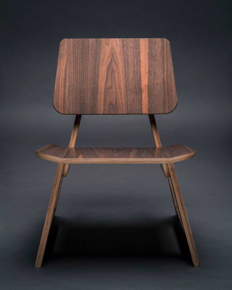 The Mafoo lounge chair is hand made to order and can be made in a variety of veneers and fabrics.